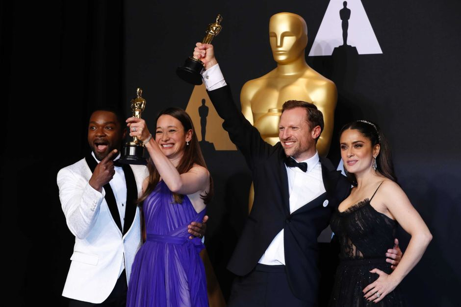 Winners of the Oscars Best Documentary Short Subject category raise the  statuette
