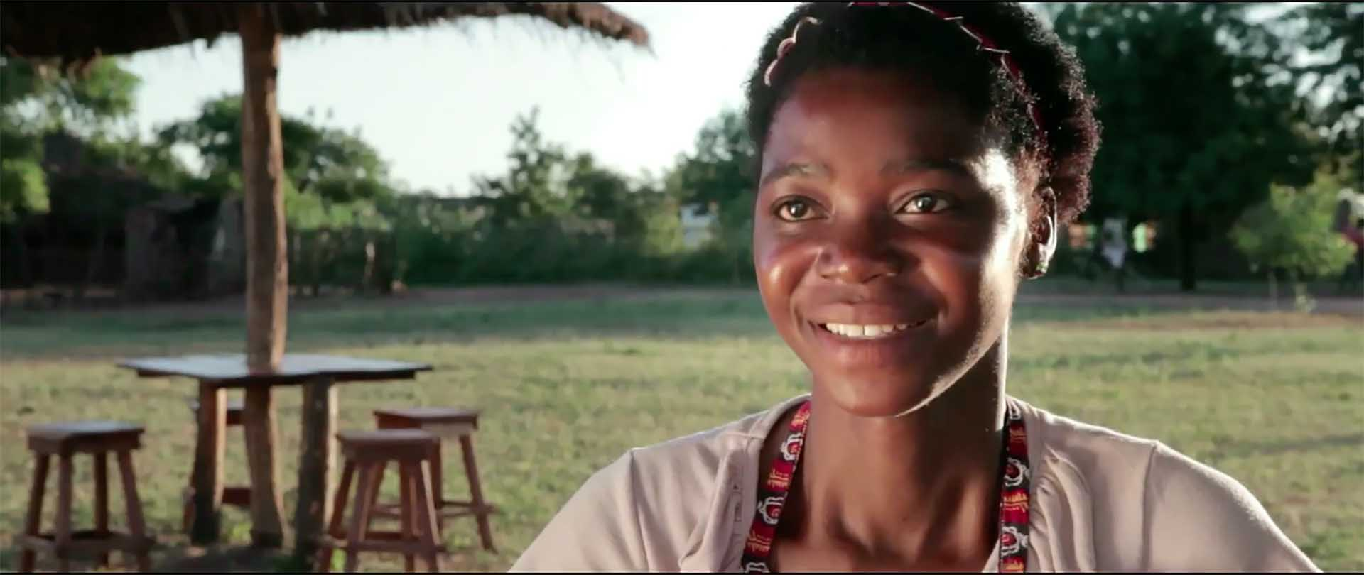 A young woman from Mozambique smiles to the camera