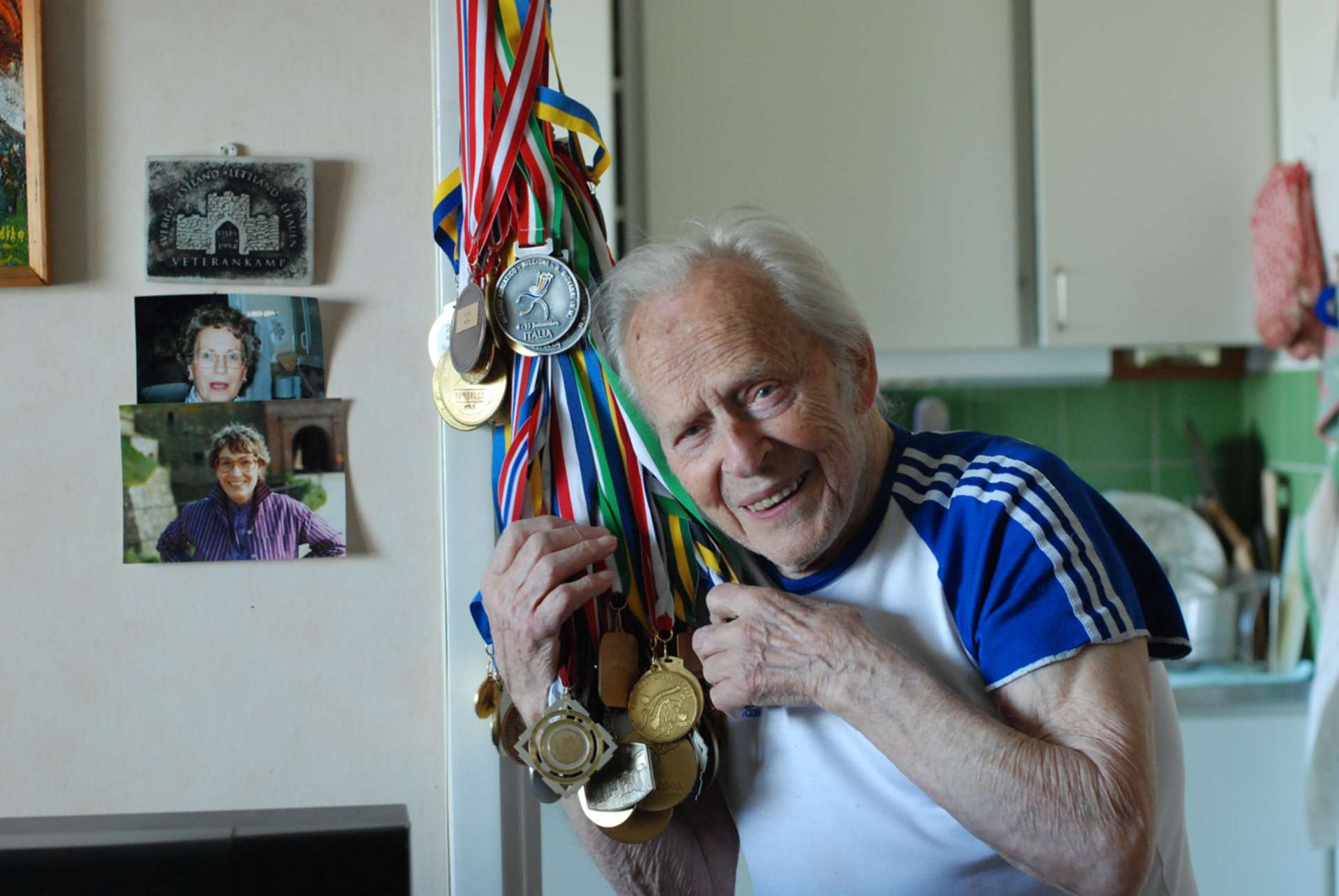 An old man shows his olympic medals in the documentary Autumn Gold