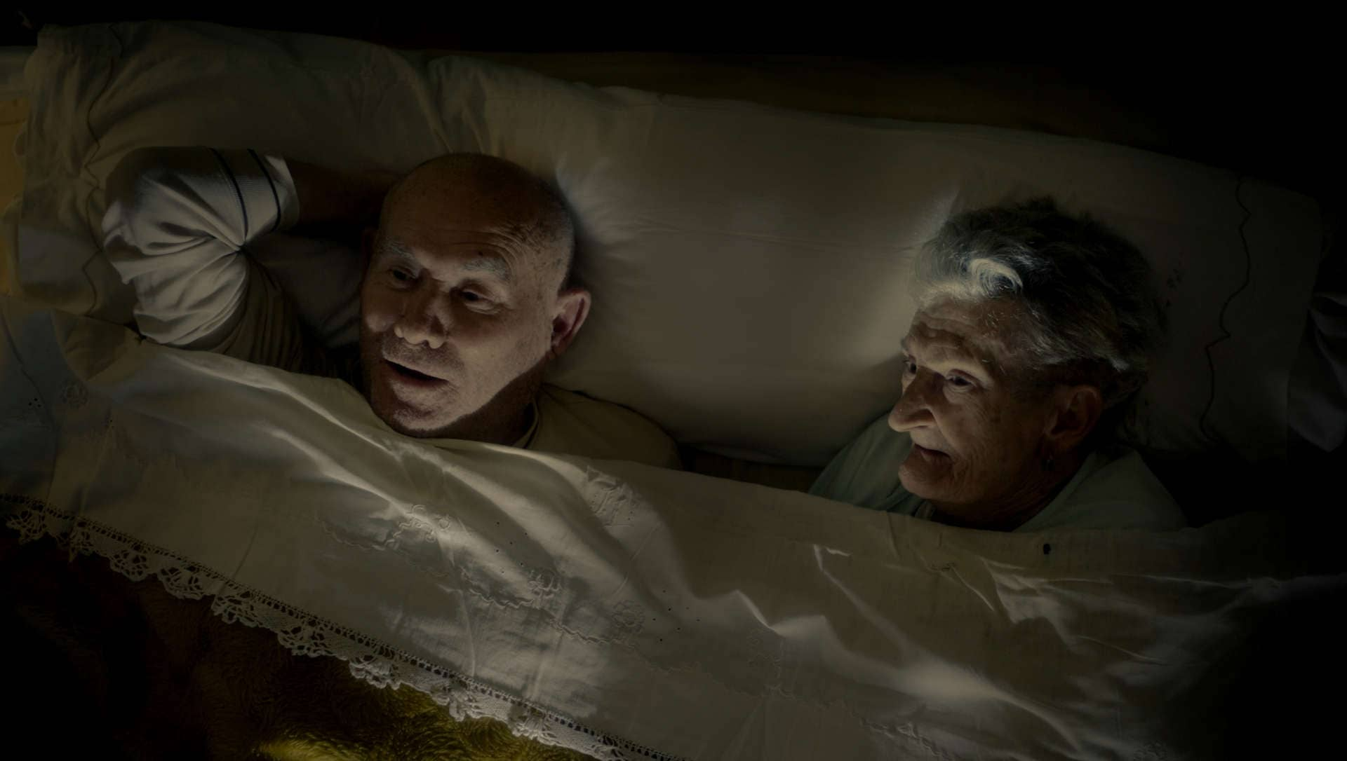 Felisa Lou and Antonio Paralluelo, an old couple, rest in their bed