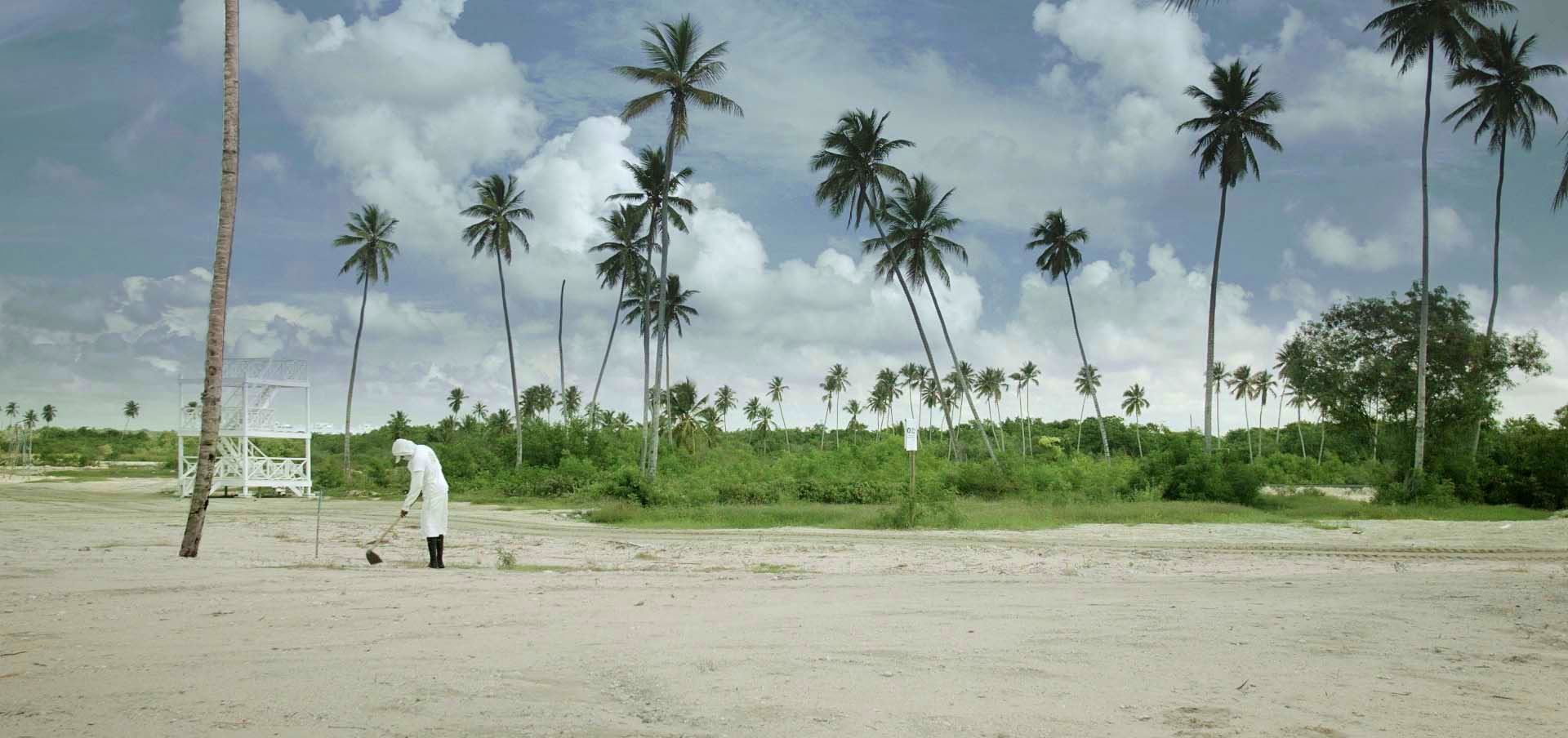 A worker in a construction site in a Domincan Republic beach in the documentary Site of Sites