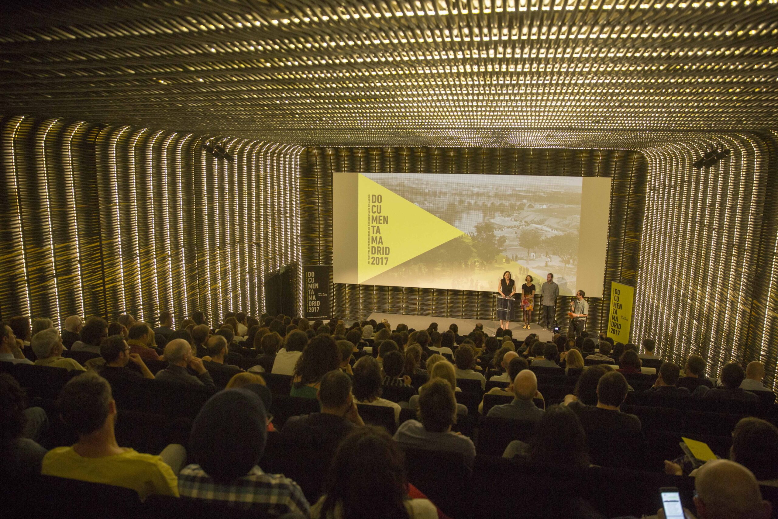 A cinema theatre full of people at a screening at Documenta Madrid