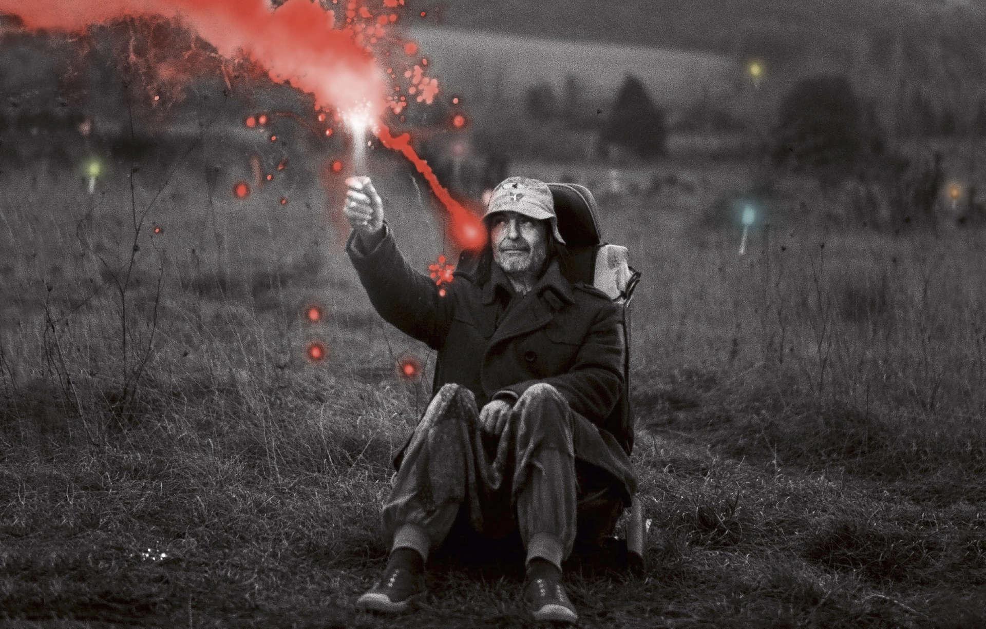 A man lights a sparkler in the film Bugarach