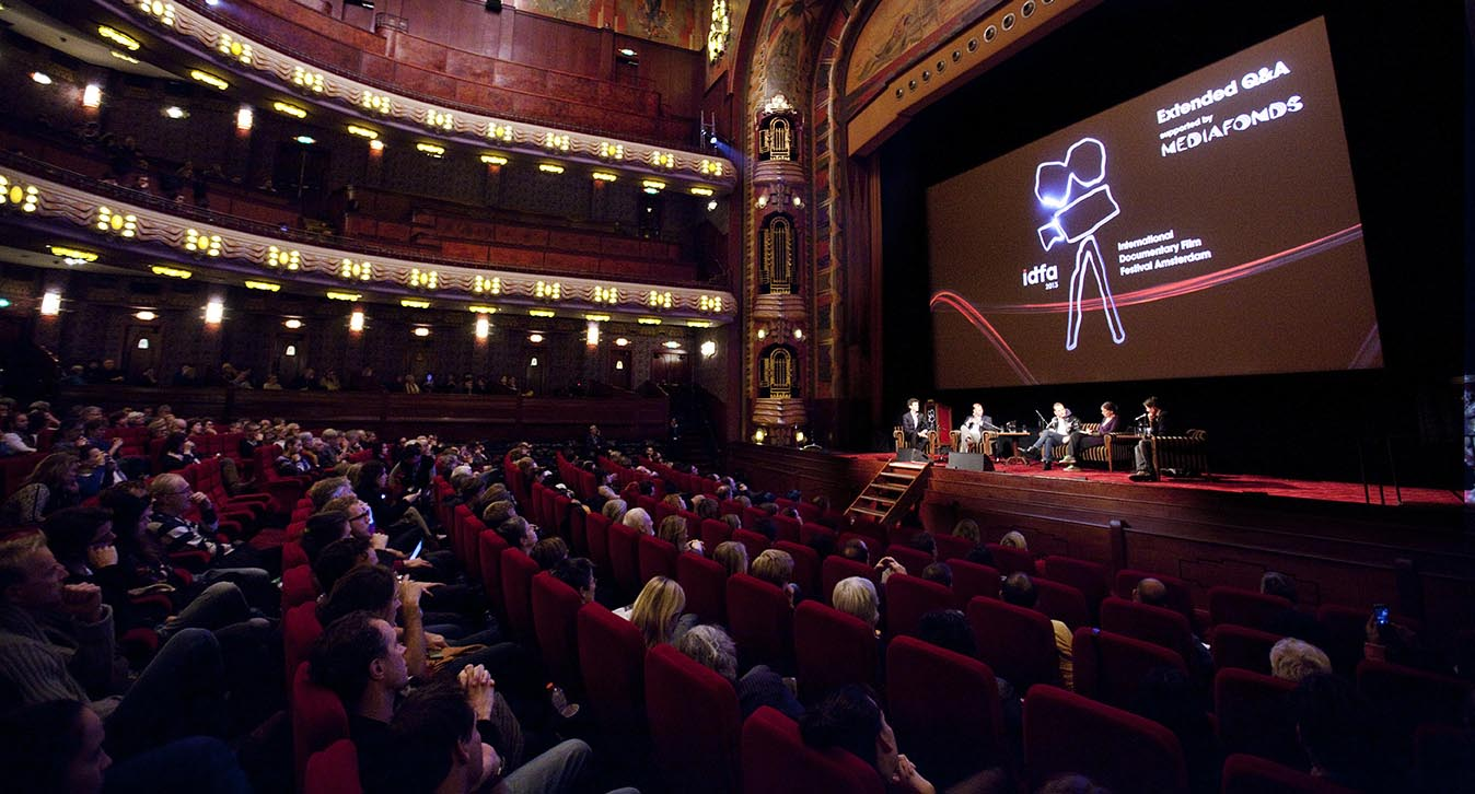 A panel discussion at a cinema theatre at IDFA